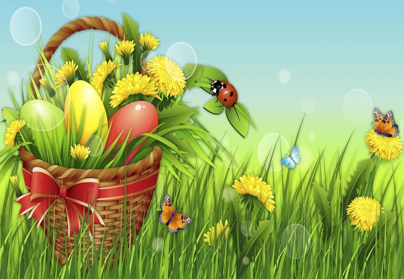 Koszyczek z jajkami i kwiatami na łące